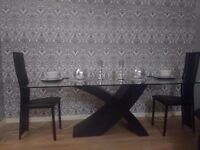 The Valencia dining table and chairs