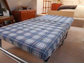 Folding single bed - easy safe storage.