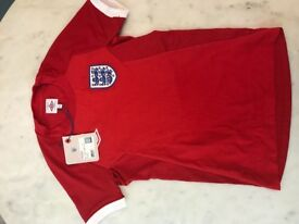 Child's England Football prior year Away Shirt, Red. Never worn, with tags.