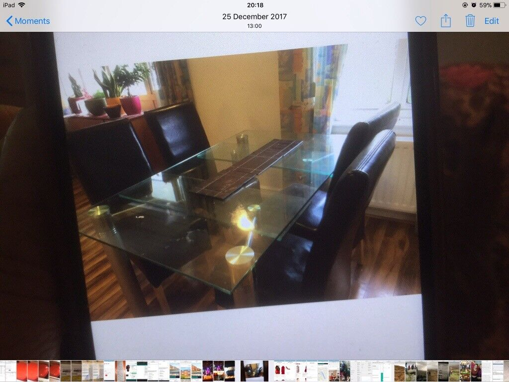 Glass Dining table and 4 chairsin Rhiwbina, Cardiff - Expanding dining table and 4 black chairs new one is now over £ 850 ; moving abroad house clearance sale. Good condition