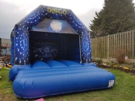 Disco bouncy castle for hire with speaker and disco light