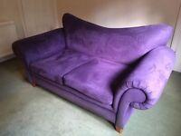 Purple 2 seater roll arm sofa