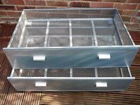 2 metal under bed storage drawers in good condition.
