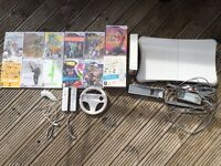 Nintendo Wii with 12 games and Wii fit board