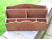 An attractive Indian wooden letter rack with brass inlay.