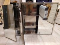 2 metal cabinets with mirror fronts
