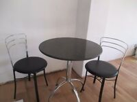 Granite top bistro table and 2 chairs.