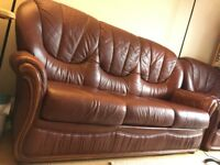 Ferrari Brown leather sofa with an armchair