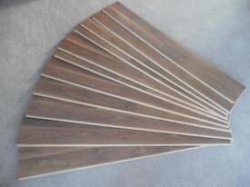 Wickes African Walnut Effect Laminate Flooring 1 pack plus 1. 11 boards in total.