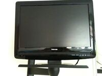 """Toshiba 19"""" colour Freeview and regular channels TV with DVD slot, stand and remote control."""