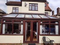 Rosewood Upvc conservatory with roof windows and 2 sets double doors. Dismantled