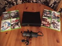 Xbox 360 for sale - 200GB with 8 games.