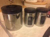 Set of brabantia kitchen storage canisters