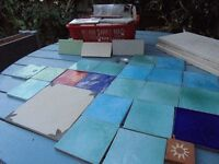 Box of 52 white tiles and fired earth tiles in blues an greens