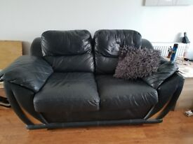 Black leather 3 piece suite and pouffe