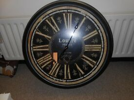 Louvre Clock. Brand New 26inches by25inches, black metal with roman numerals.