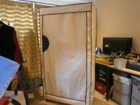 Wardrobe with metal frame and canvas cover