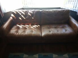 Beautiful soft tan leather sofa, from Harvey Norman. Cost £3000. Will accept £600 or nearest offer