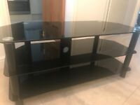 Black glass tv stand , with 3 shelves . Pristine , no marks !