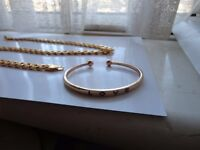 "24 ""gold chain very heavy, gold watch, gold love bangle all new, look very like gold"