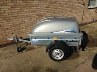Trailer 5'x3 ' with lockable lid.