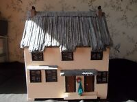 miniature thatched cottage with furniture