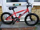 """BOYS 18"""" WHEEL OUTRAGE BIKE IN GREAT WORKING CONDITION AGE 5+ NO RUST"""