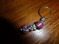 Brand new never worn charm bracelet and key ring