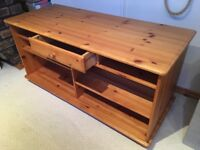 Pine TV cabinet with multiple shelves and drawer.