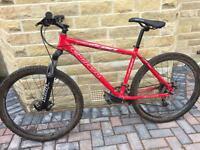 Red Carrera Vulcan mountain bike