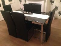 Black dinning table with 6 leather chairs