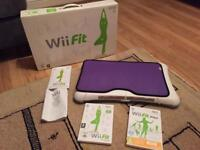 Wii Fit Balance Board and 2 fitness discs