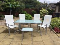 Smoked Glass Table & 4 folding/reclining Chairs +a small, matching drinks table