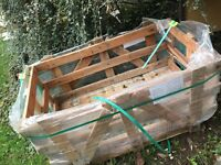 Sturdy wooden storage crate from paving stones. £5