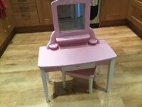Girls pink dressing table and stool. It has a fitted mirror and a small drawer.