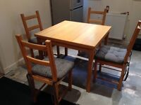 Extending Pine table and 4 chairs