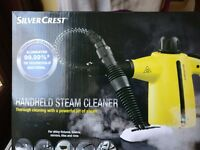 Handheld steam cleaner boxed