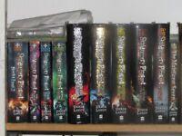 Skulduggery Pleasant series and The Demon Road Trilogy by Derek Landy