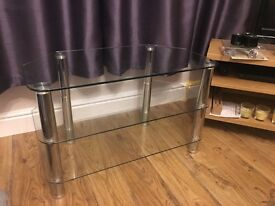 3 shelf glass TV stand with silver chrome legs.