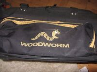 WOODWORM CRICKET BAG GOLD AND BLACK WITH WHEELS - USED