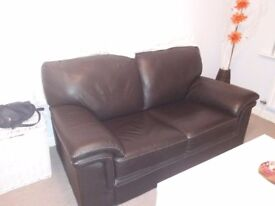 2 seater leather sofa in great conditions only £50.00