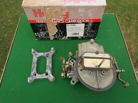 Holley carburetor 2 barrel 350cfm and Edelbrock air filter.