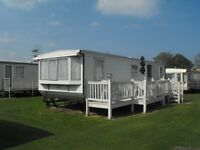 Holiday caravan 3 bed 8 berth,100mtrs from beach.On a family site.close to attractions