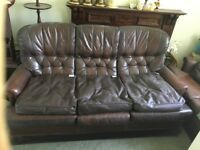 3 piece suite in brown leather.