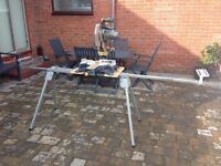 CROSS CUT AND MITRE SAW WITH ADJUSTABLE STAND