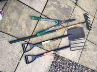 Garden fork,rake, spade and two extendable shears