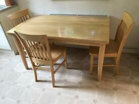 Modern kitchen table with 3 chairs.