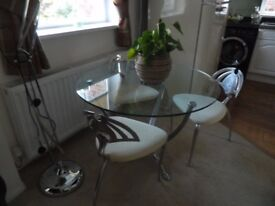 Dining room circular glass table and 4 chairs
