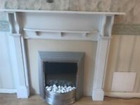 White wooden surround with silver electric white stone effect fire
