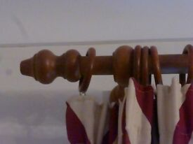 Wooden curtain pole,length 2.5metres, diameter approx 3cm, 26 rings